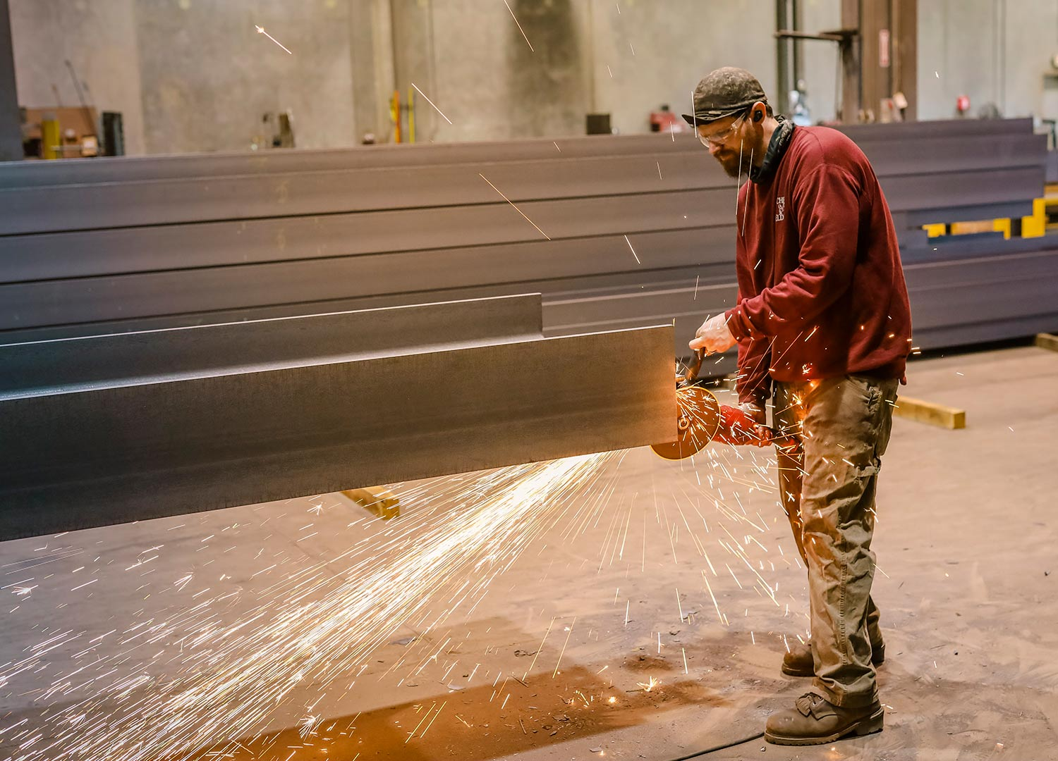 Finishing a steel beam with a grinder