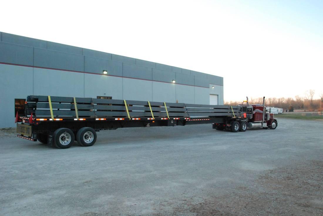 Tincher's Welding steel beams on truck